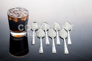 Concept of fizzy cola drinks with unhealthy sugar content - ThamKC Royalty-Free Photos