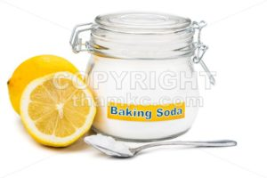 Spoonful of baking soda and lemon fruits for multiple holistic usages. - ThamKC Royalty-Free Photos