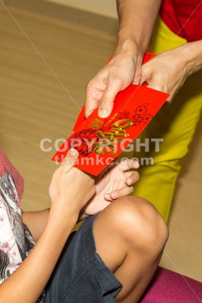Chinese person giving red packet with Good Luck Chinese word - ThamKC Royalty-Free Photos