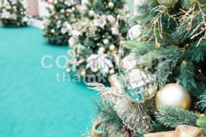 Closeup of Christmas tree with ornaments and green background - ThamKC Royalty-Free Photos