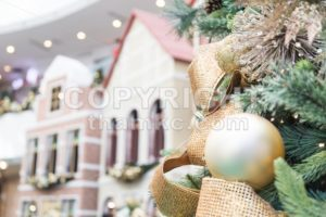 Closeup of Christmas tree with ornaments and home background - ThamKC Royalty-Free Photos