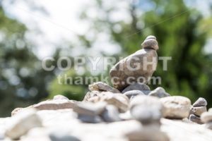 Closeup of Zen rock arrangement with nature background - ThamKC Royalty-Free Photos
