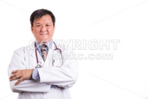 Confident matured Asian doctor with folded arms - ThamKC Royalty-Free Photos