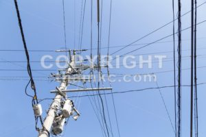 Electricity pole with wires grid with blue sky - ThamKC Royalty-Free Photos