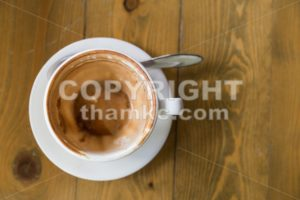 Empty cup and saucer with coffee stain - ThamKC Royalty-Free Photos