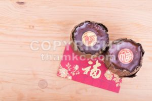 Glutinous rice cake with Good Luck in Chinese words - ThamKC Royalty-Free Photos