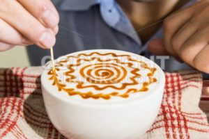 Series of person decorating coffee with art - ThamKC Royalty-Free Photos