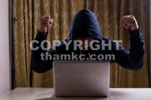 Asian hacker raise hands after successful hacked into network - ThamKC Royalty-Free Photos