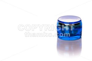 Blue skincare cosmetic jar on white background - ThamKC Royalty-Free Photos
