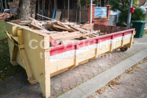 Construction rubbish dumpster with waste at construction site - ThamKC Royalty-Free Photos