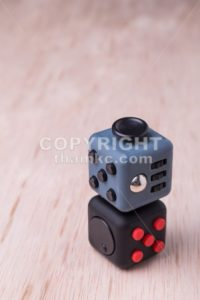 Fidget cube, the stress relieving cube on table top - ThamKC Royalty-Free Photos