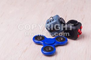 Fidget spinner and fidget cube, the latest stress relieving craze - ThamKC Royalty-Free Photos
