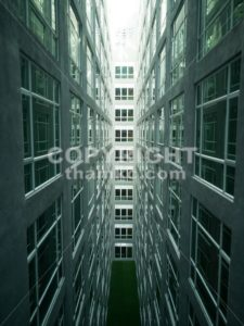 Series of narrow claustrophobia courtyard with glass window - ThamKC Royalty-Free Photos