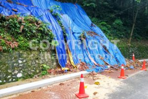 Cones barricade dangerous collapsed eroded hill slope area - ThamKC Royalty-Free Photos