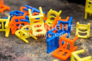 Heap of colorful chairs from the Stacking Chairs Game - ThamKC Royalty-Free Photos
