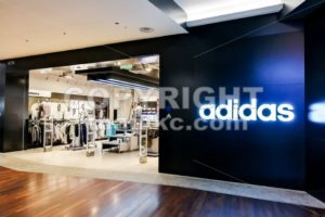 KUALA LUMPUR, Malaysia, June 25, 2017: Adidas AG is a German multinational corporation, headquartered in Herzogenaurach, Germany, that designs and manufactures shoes, clothing and accessories. - ThamKC Royalty-Free Photos