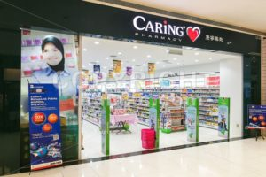 KUALA LUMPUR, Malaysia, June 25, 2017:  CARiNG Pharmacy Group Berhad operates a chain of community pharmacies They carry pharmaceutical, personal care products, medical, and healthcare devices. - ThamKC Royalty-Free Photos
