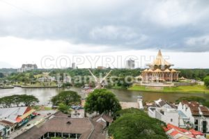 KUCHING, Malaysia, June 25, 2017:  Overview of Kuching city waterfront, popular tourism destination in Sarawak. State Legislative Assembly building in foreground - ThamKC Royalty-Free Photos