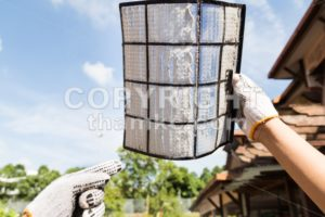 Person pointing on thick dirty dust on air conditioner filter - ThamKC Royalty-Free Photos