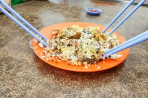 Plate of fried carrot cake or kueh kak. - ThamKC Royalty-Free Photos