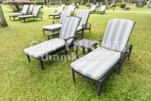 Relaxing deck chairs at tropical resort with nobody - ThamKC Royalty-Free Photos