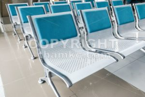 Rows of empty chairs at waiting area - ThamKC Royalty-Free Photos