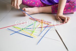 Series of kid playing pick up sticks fun game - ThamKC Royalty-Free Photos