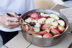 Soak apple in water with salt to prevent oxidation - ThamKC Royalty-Free Photos