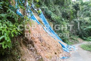 Soil erosion at tropical hilly terrain due to rain storm. - ThamKC Royalty-Free Photos