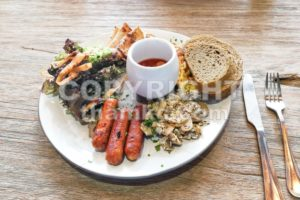 Big breakfast of sausage, mushroom, baked beans, salad wholemeal bread - ThamKC Royalty-Free Photos
