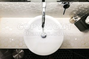 Modern contemporary wash basin with running water from tap faucet - ThamKC Royalty-Free Photos