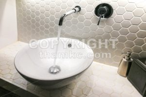Modern wash basin with running water from tap faucet - ThamKC Royalty-Free Photos