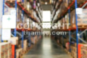 De-focused warehouse racks with inventory - ThamKC Royalty-Free Photos
