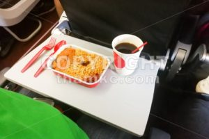 Simple in-flight meal of rice, meat, coffee in disposable utensils - ThamKC Royalty-Free Photos