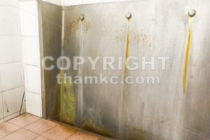 Unhygienic dirty urinal with limescale stain built up - ThamKC Royalty-Free Photos