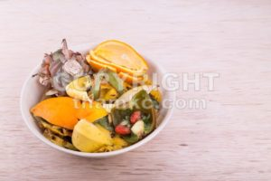 Bowl of household vegetable and fruits refuse collected for compost - ThamKC Royalty-Free Photos