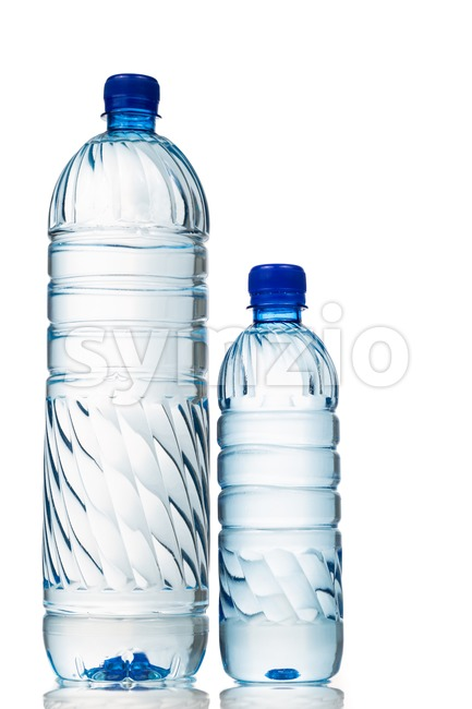 Big and small mineral water in plastic bottle white background Stock Photo