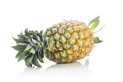 Fresh whole juicy and nutritious pineapple fruit against white background. Stock Photo