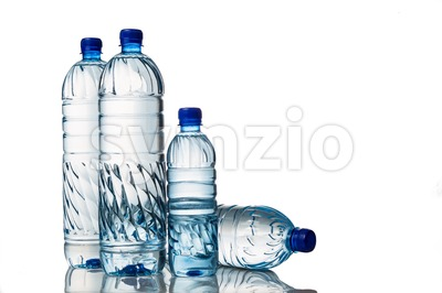Four refreshing mineral water in plastic bottle in white background Stock Photo