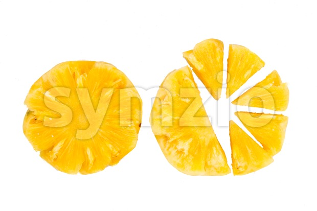 Freshly cut juicy, sweet nutritious pineapple fruit isolated in white