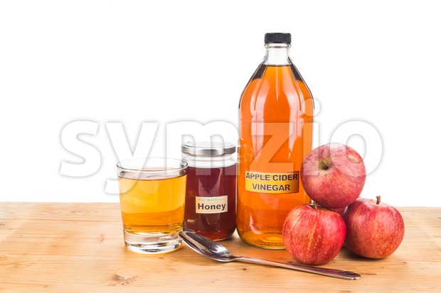 Apple cider vinegar with honey, natural remedies and cures for common health condition. Stock Photo