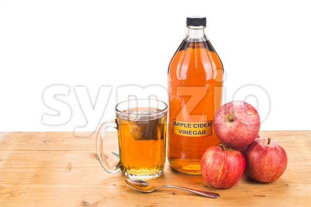 Apple cider vinegar with brewed tea, natural remedies and cures for common health condition. Stock Photo
