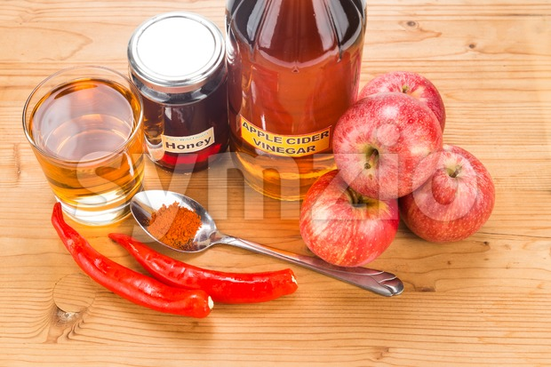 Apple cider vinegar with honey and cayenne pepper, natural remedies and cures for common health condition. Stock Photo