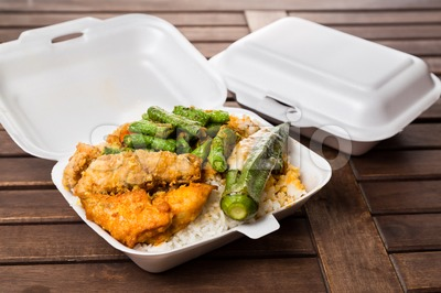 Convenient but unhealthy polystyrene lunch boxes with take away meal Stock Photo