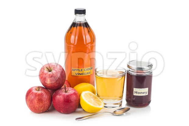 Apple cider vinegar with honey and lemon, natural remedies and cures for common health condition. Stock Photo