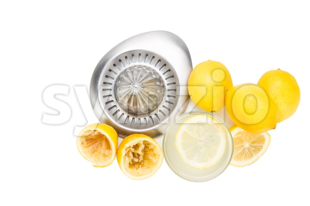 Freshly squeezed organic lemon juice with glass and squeezer