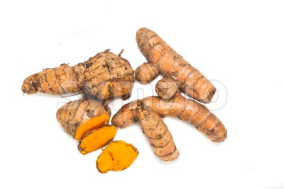 Fresh turmeric roots with healing properties on white background. Stock Photo