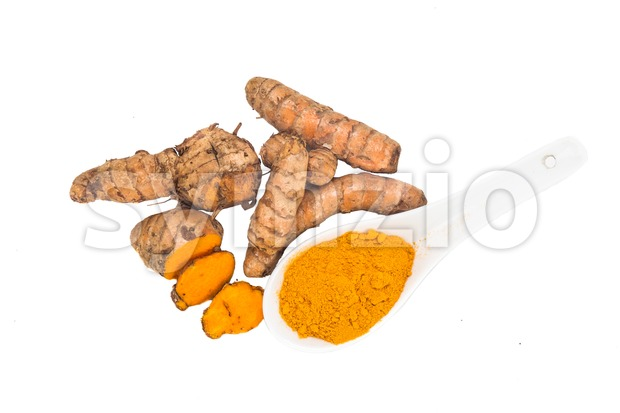 Turmeric roots and powder, healthy food with healing properties. Stock Photo