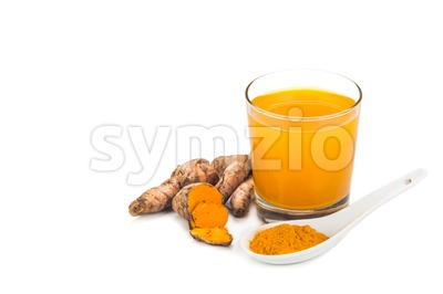 Healthy turmeric roots drinks in a transparent glass. Stock Photo