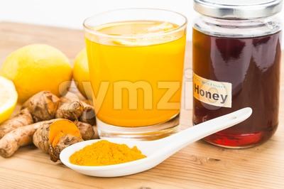 Turmeric roots with lemon and honey drinks, powerful healing beverage. Stock Photo